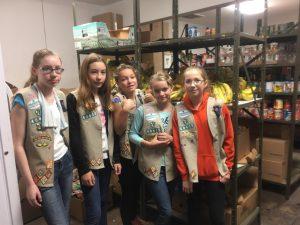 Girl Scout Troop Volunteers in Food Pantry
